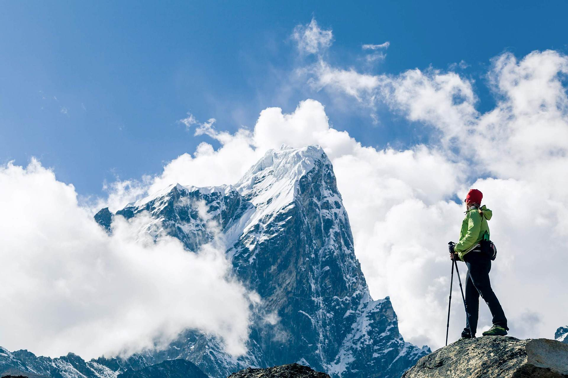 Young woman hiker hiking in Himalaya Mountains in Nepal.